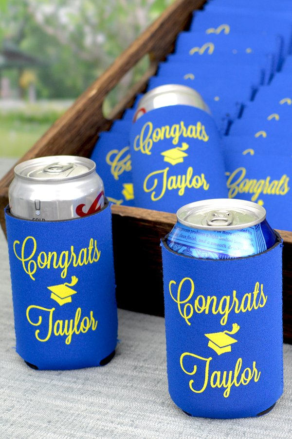 Custom printed royal blue neoprene collapsible can coolers with yellow imprint, personalized with graduation congrats cap design and custom text in Lovable lettering style