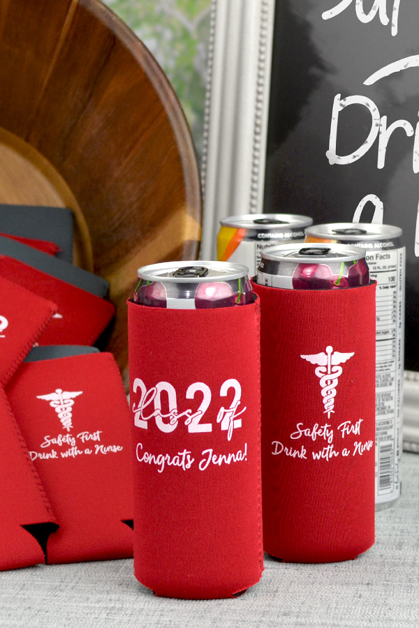 Red slim can coolers with white imprint, G1217 and 2145 designs, and 3 lines of custom print