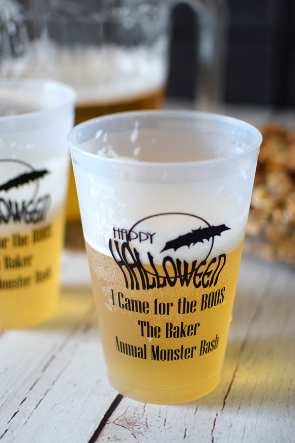 Frosted cups printed with black imprint, 1252 Halloween design, and three lines of text in Mature lettering style