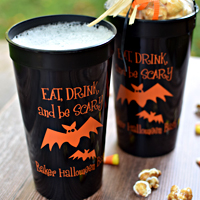 Black jumbo 32 oz stadium cups printed with orange imprint, bat design, and three lines of text in Dimwit lettering style
