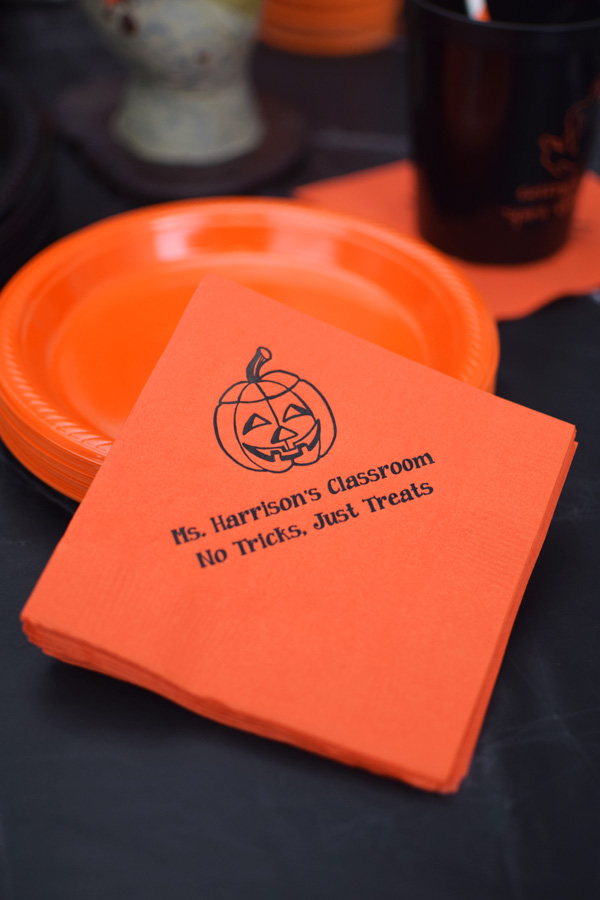 Orange napkins printed with Black imprint color, 1255 design, and two lines of text in Nutty lettering style