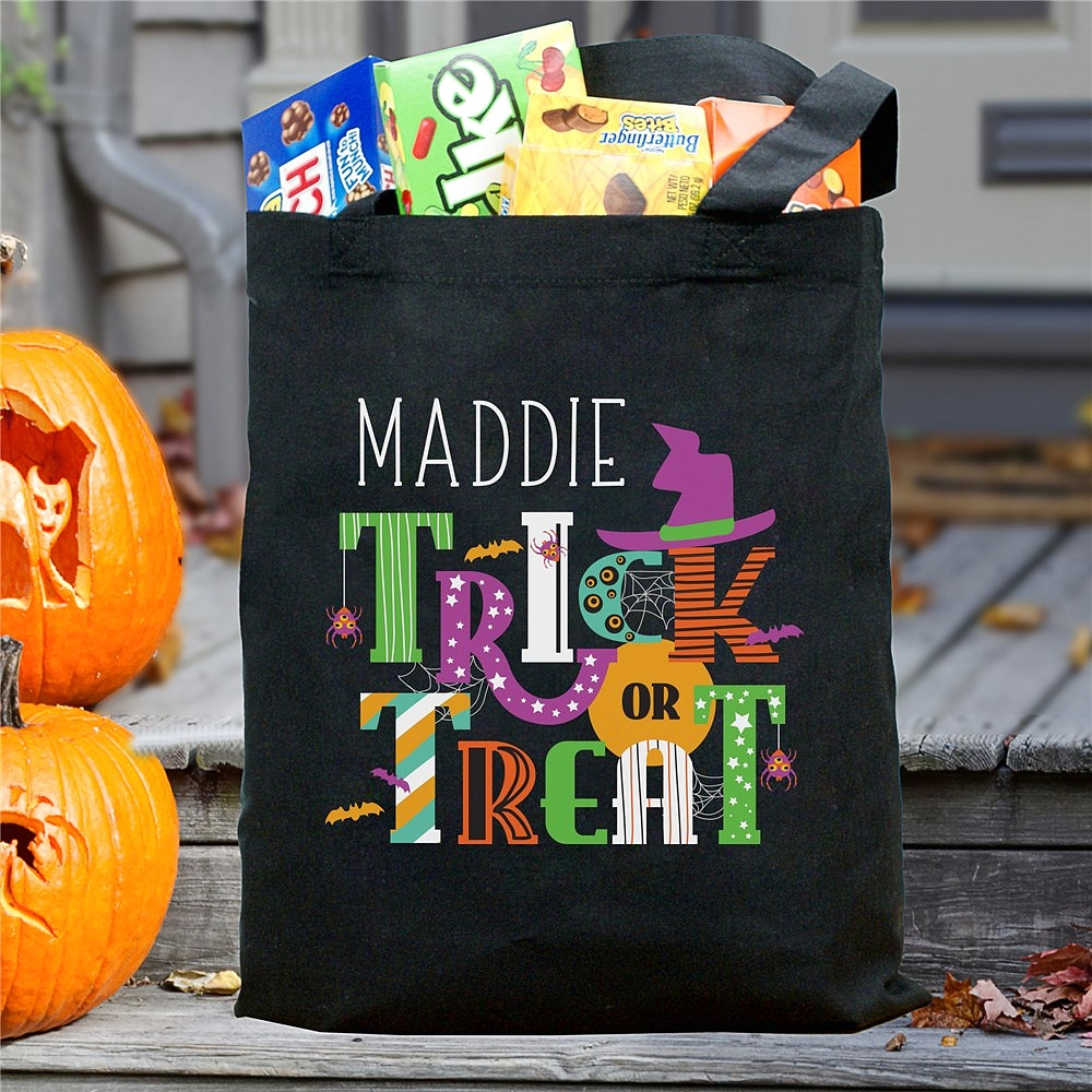 Black canvas Halloween candy bag personalized with big bold 'TRICK OR TREAT' wording and child's first name