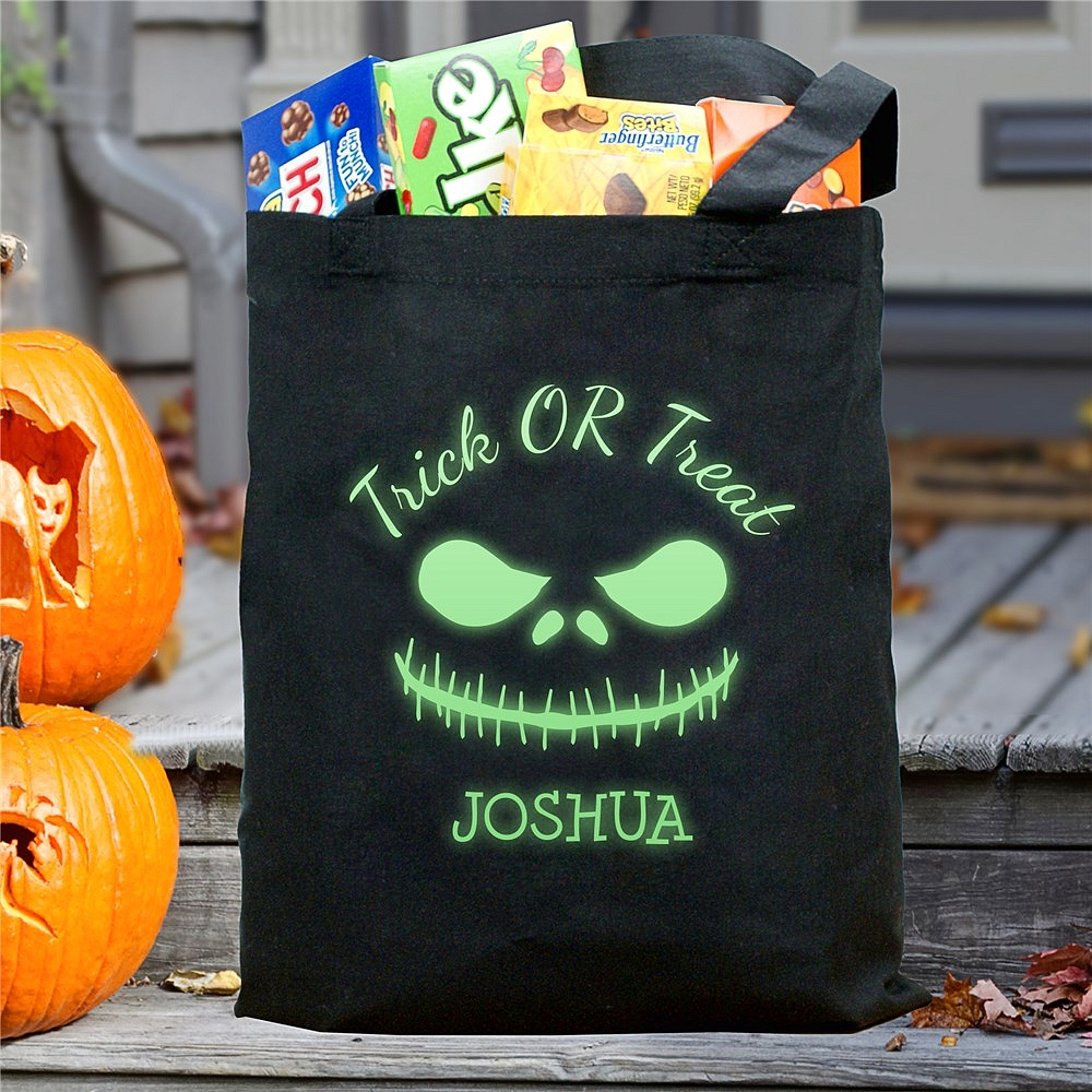Black canvas Halloween trick or treat bag personalized with glow-in-the-dark scary face and name