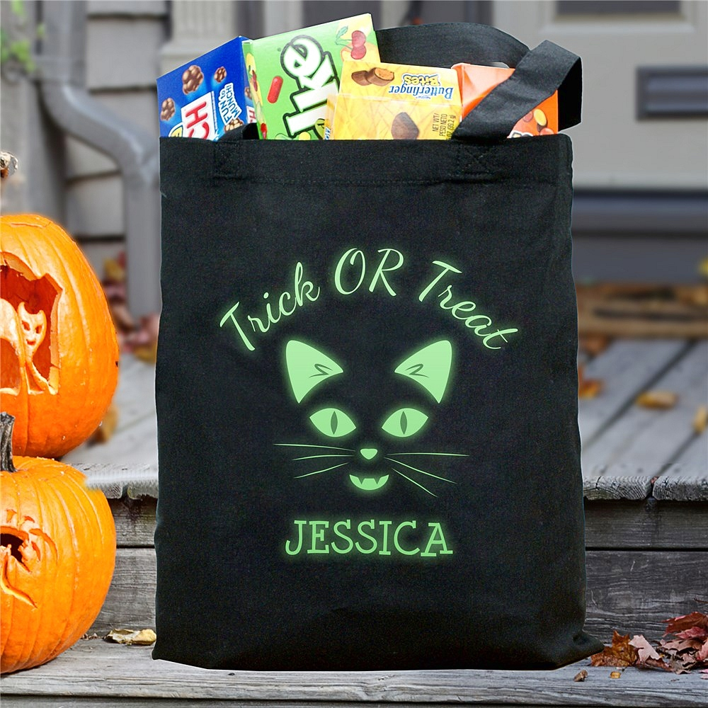 Black canvas Halloween trick or treat bag personalized with glow-in-the-dark cat face and custom name