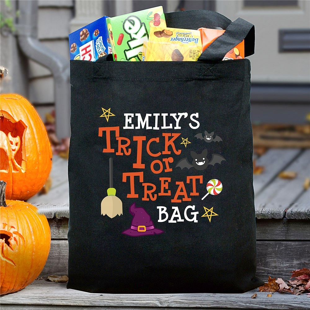 Black canvas Halloween trick or treat bag personalized with bats, witch hat and broom and child's name