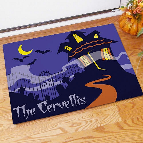 Haunted house Halloween doormat personalized with family name