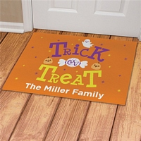 Orange Trick or Treat Halloween floormat with pumpkins and ghost personalized with family name