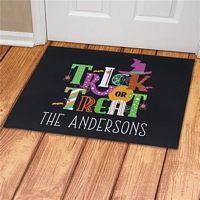 Trick or Treat Halloween welcome door mat personalized with family name
