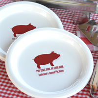 Personalized White Dinner Plates with Dark Red imprint, custom printed with SUM107 design and two lines of text in Mature lettering style