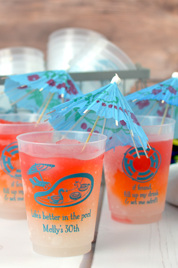 Personalized summer pool party souvenir frosted plastic cups with Turquoise imprint, custom printed with designs SUM129 and SUM132 and text in Sweetheart lettering style