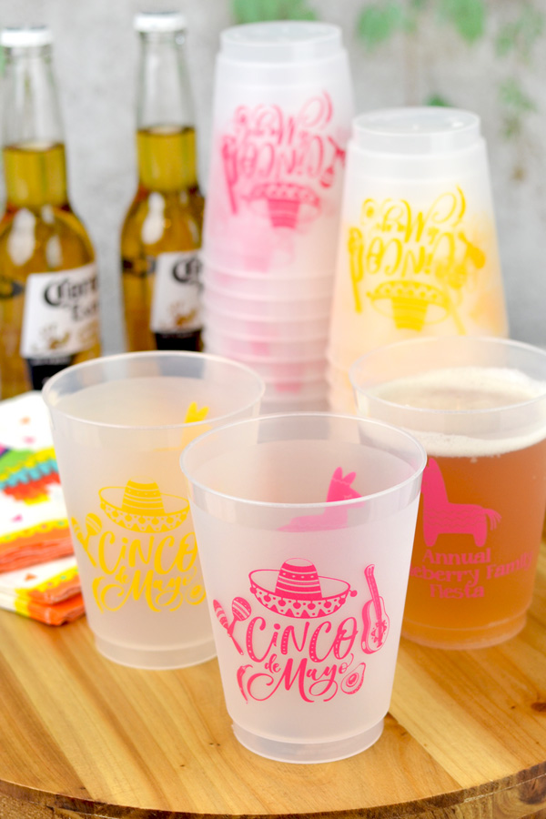 Personalized 16 Ounce Frosted Plastic Cups for Cinco De Mayo with Yellow – 123C and Hot Pink – 214C imprint colors, Nutty lettering style, and designs SUM134 and SUM138