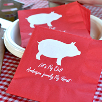 Custom printed Red 3-Ply Luncheon Napkins with White imprint, personalized with SUM107 design and two lines of text in Radiant Beauty lettering style