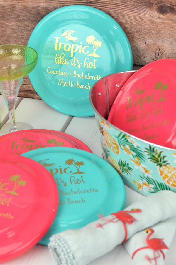Personalized flying discs in Bright Pink and Bright Aqua with Gold imprint, design and two lines of print